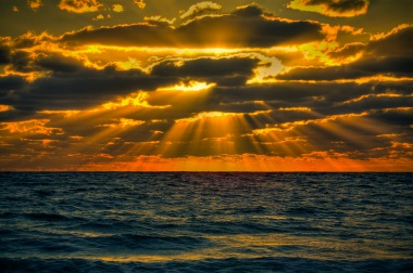 sunrise-over-atlantic-ocean-with-sun-rays-going-trhough-clouds